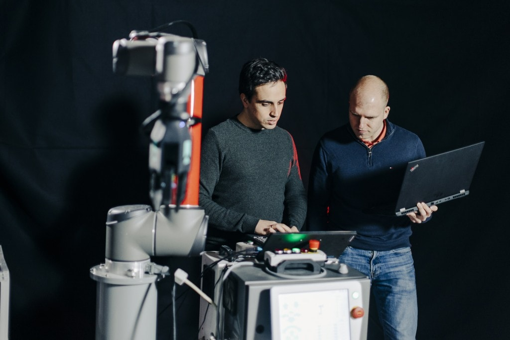 Two Element Logic employees are testing new, technological equipment.
